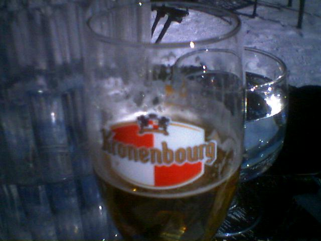 Kronenbourg beer glass half full
